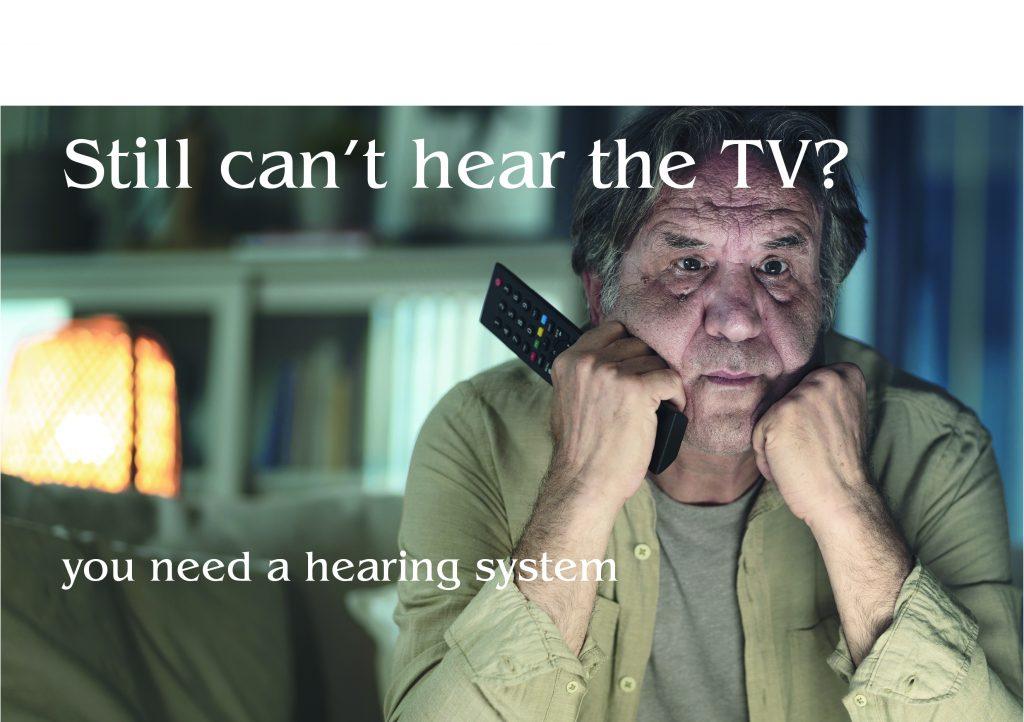 photo of man watchin tv